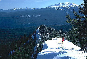 Diamond Peak is seen here from Mt. Fuji near Waldo Lake, with Eugene writer Doug Newman in the foreground,